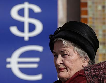 Курс доллара ушел ниже 65 рублей на открытии торгов